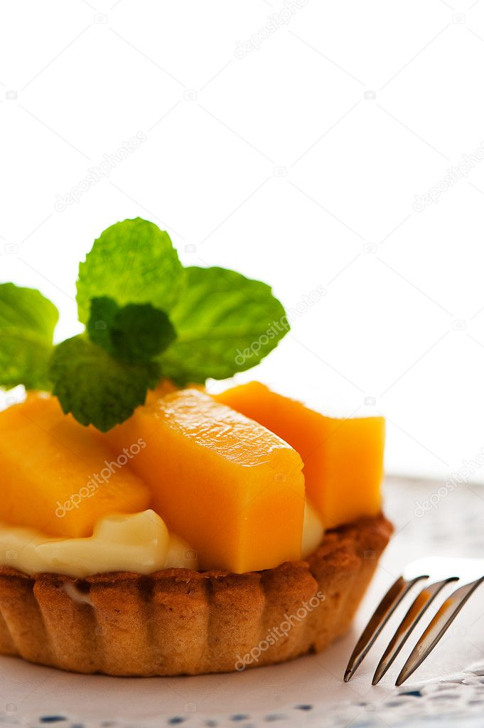 French tart with mango and vanilla pudding on white background a