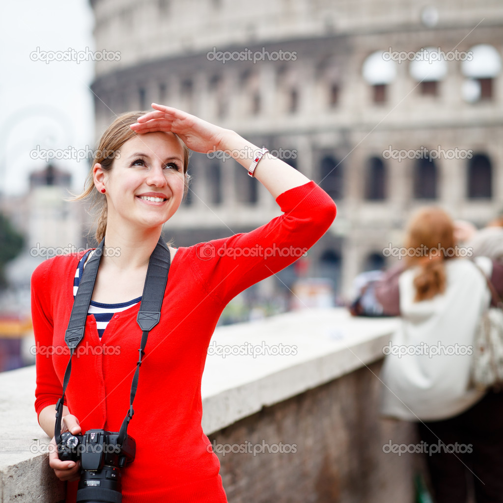 Portrait of a pretty young tourist taking photographs