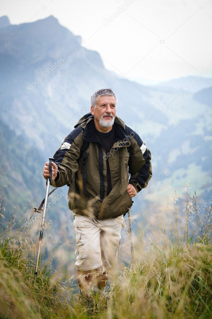 Active senior hiking in mountains (Swiss Alps)