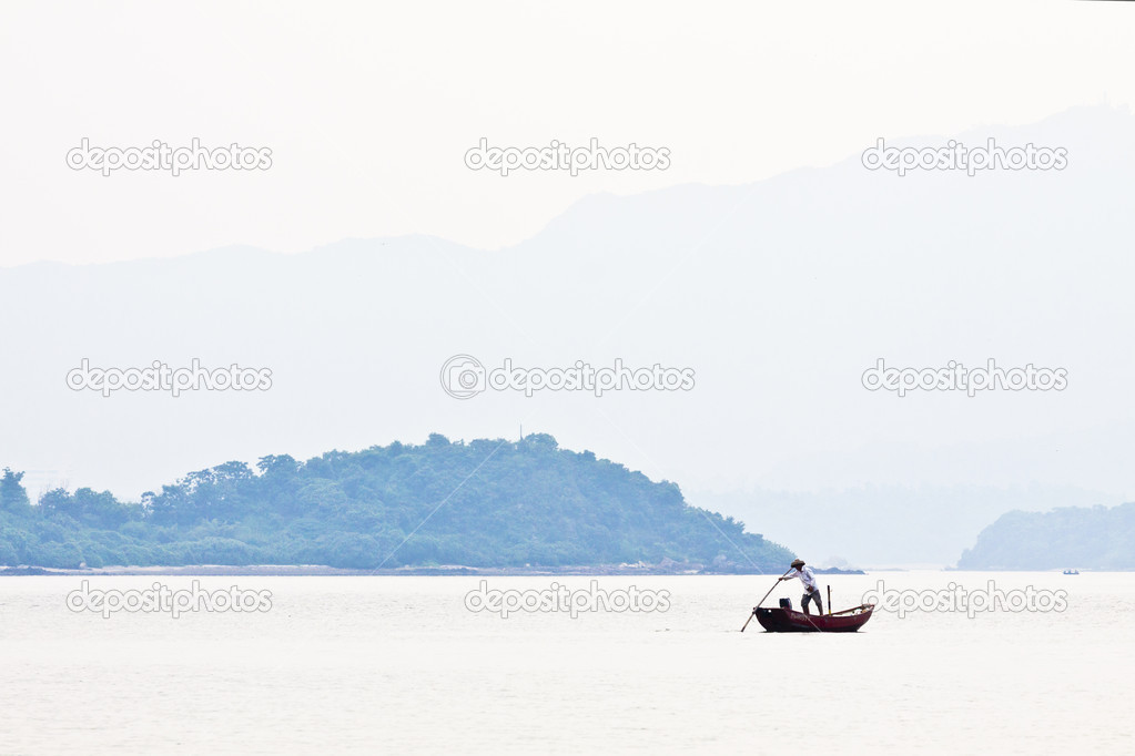 Fisherman over the mountain and the sea alone