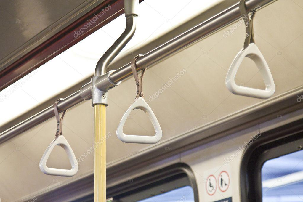 Handles for standing passenger inside a train
