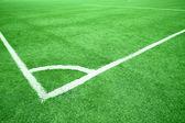 Fényképek foci-mező sarkában