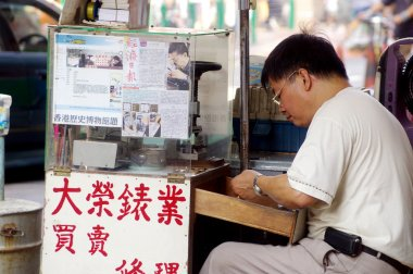 A man concentrating on making watch in Hong Kong