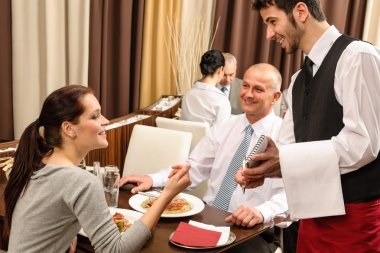 Business lunch waiter taking order at restaurant