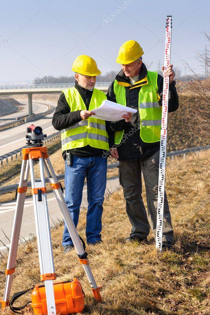 Geodesist read plans on construction site stock photo for How to read construction site plans