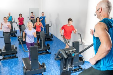 Class of young adults with fitness trainer
