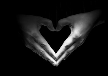 Hands unite with eachother in love symbol