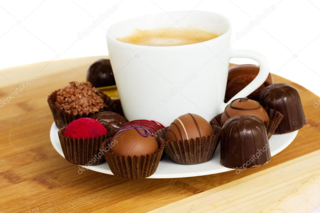 https://static8.depositphotos.com/1038919/1065/i/950/depositphotos_10651199-stock-photo-cup-of-coffee-with-sweets.jpg