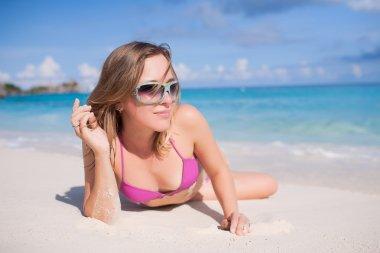 Pretty Blond Female Lying On Beach