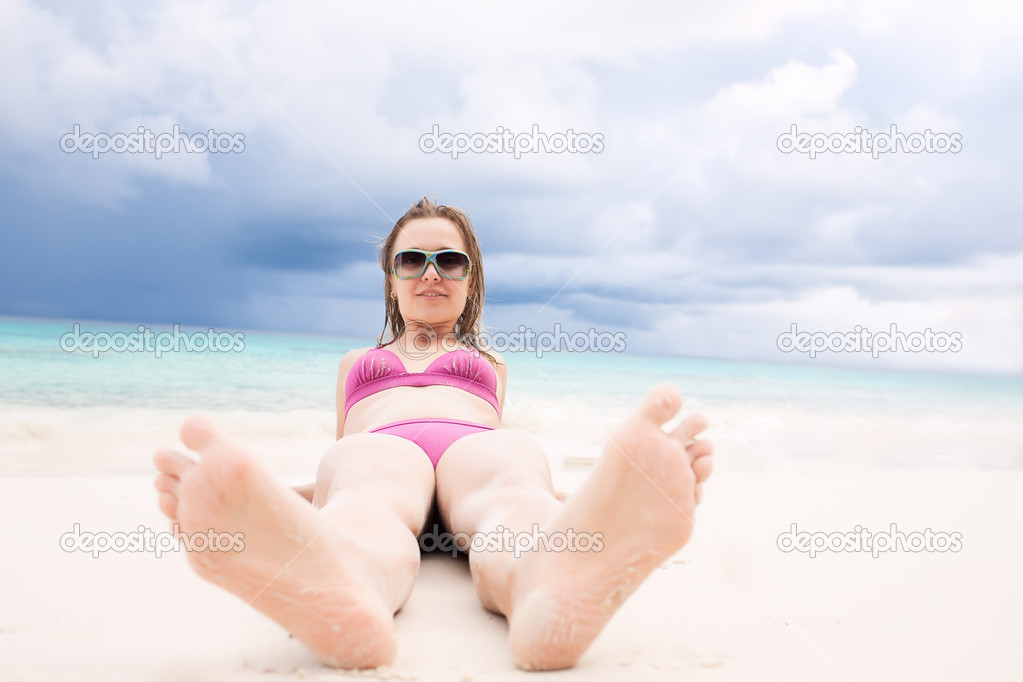 Girl lying on the beachfront