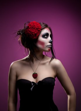 Young woman in day of the dead mask skull face art