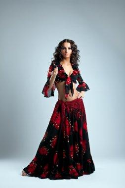 Cute woman posing in gypsy costume
