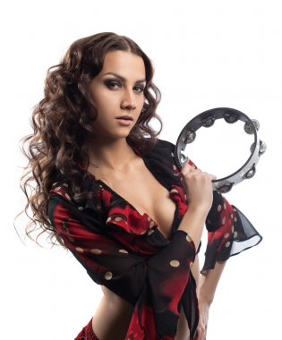 Young gypsy girl play with tambourine