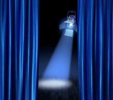Stage spotlight blue curtains