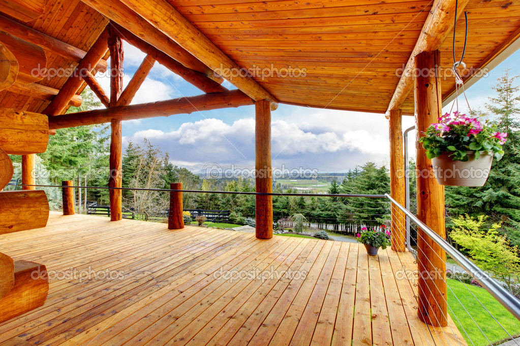 Beautiful View Of The Log Cabin House Porch Stock Photo