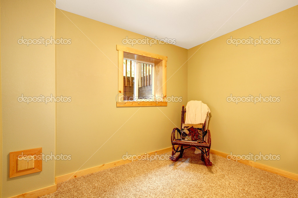simple empty basement bedroom with chair stock photo iriana88w 10227717. Black Bedroom Furniture Sets. Home Design Ideas