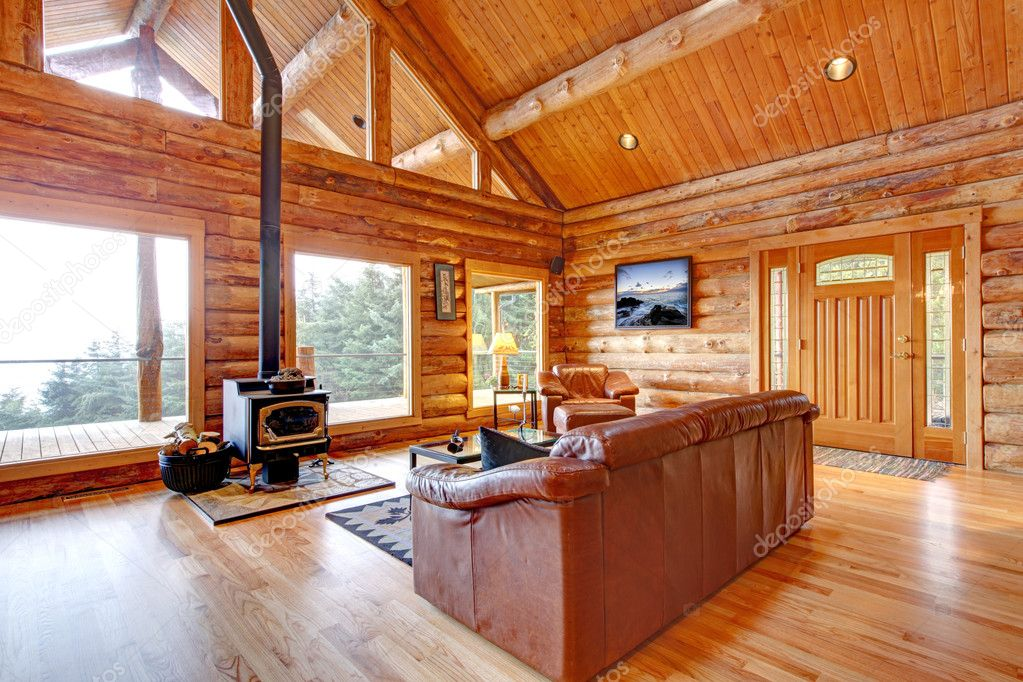 Luxury log cabin living room with leather sofa. — Stock Photo ...
