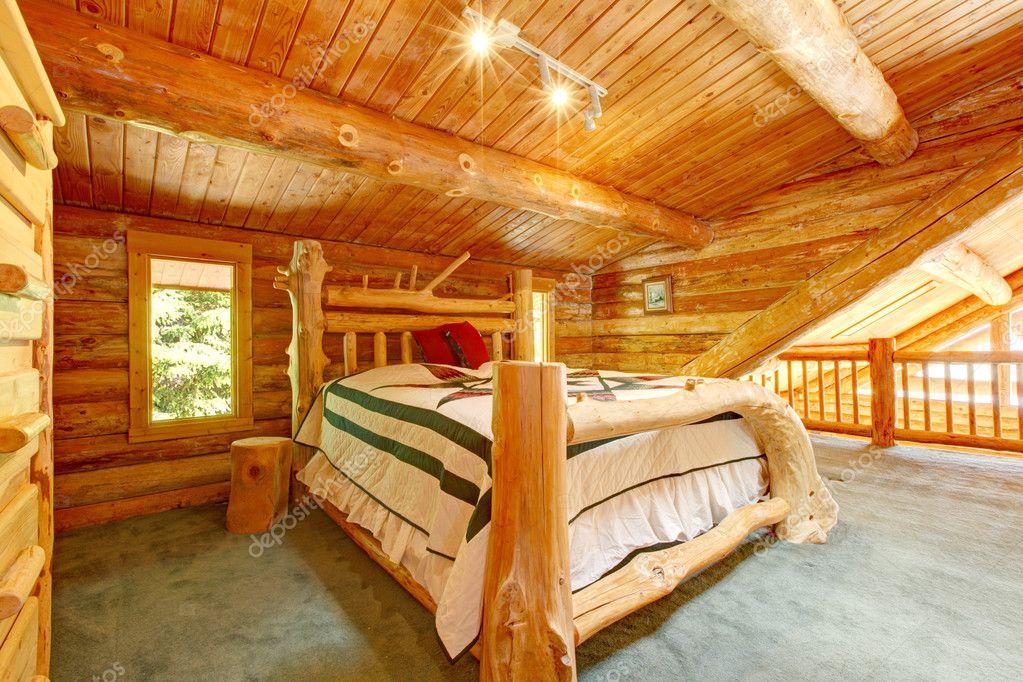 Log Cabin Bedroom Under Wood Large Ceiling Stock Photo