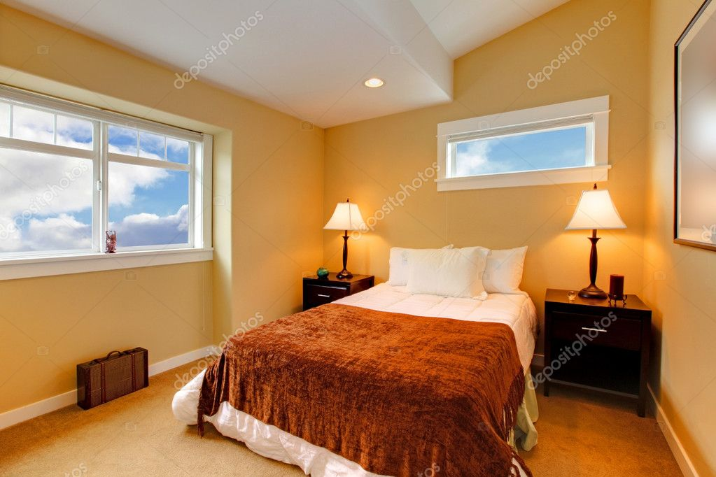 bedroom with yellow mustard paint and brown bedding stock photo iriana88w 8875297. Black Bedroom Furniture Sets. Home Design Ideas