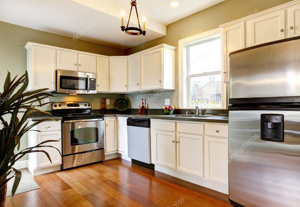 Classic white and green new kitchen with cherry floor. — Stock Photo ...
