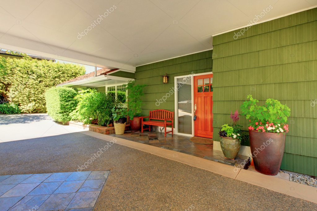 Front door and green house with nice curb appeal.