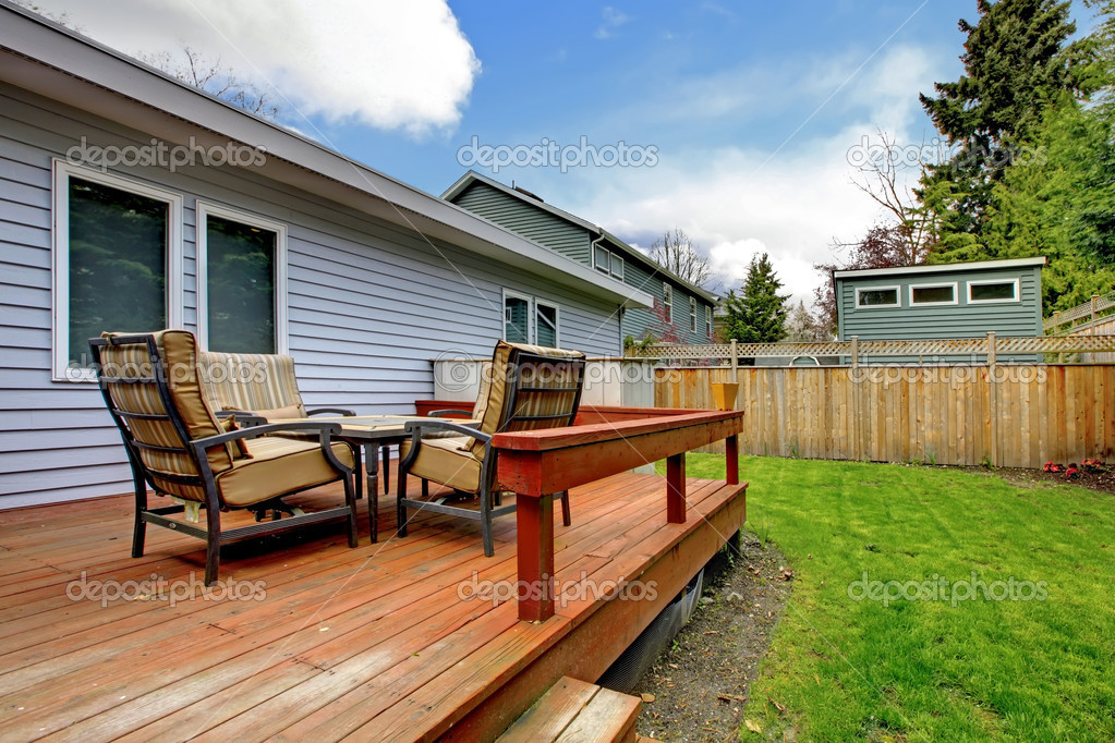Grey Small House With Simple Deck And Outdoor Chairs Stock Photo 169 Iriana88w 9289379