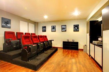 Home TV movie theater entertainment room interior.