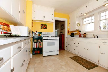White and yellow old simple kitchen.