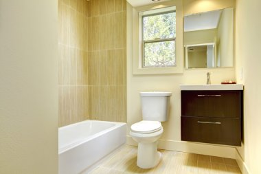 New modern yellow bathroom with beige tiles.
