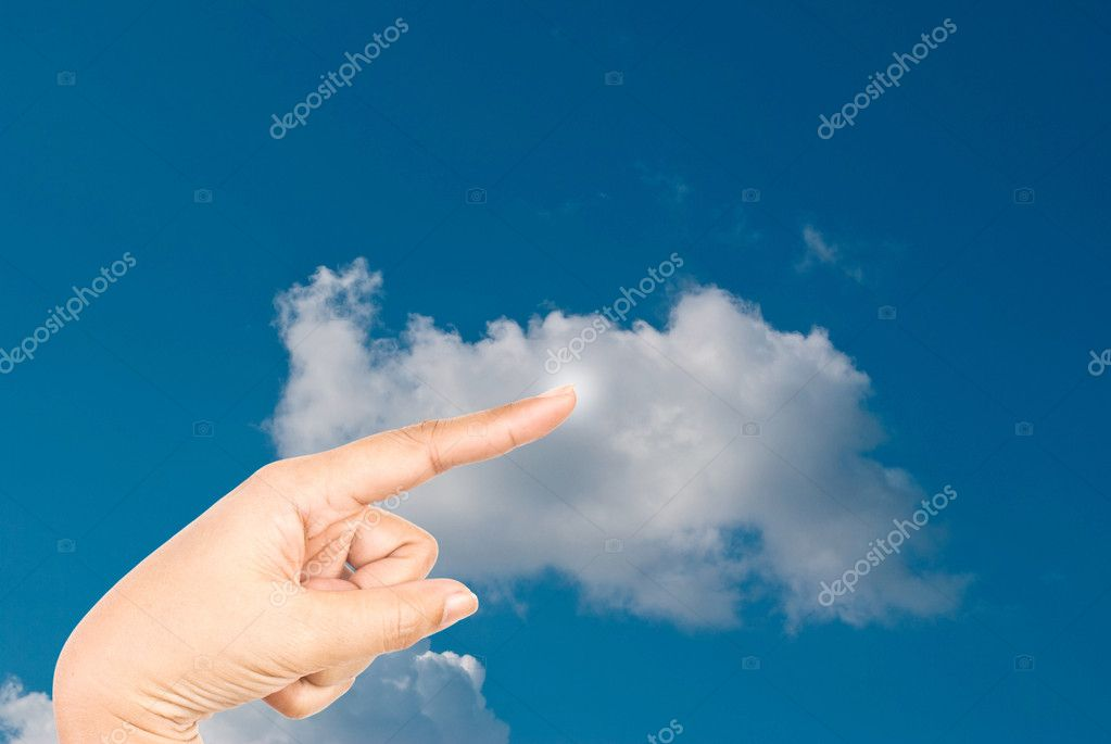 Hand pressing cloud on the sky.
