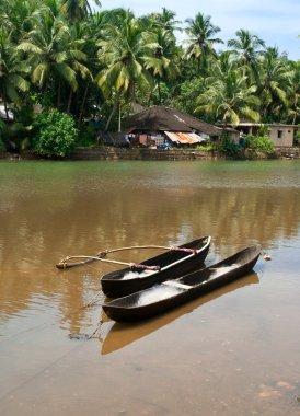 Fishing boats in tropical river near indian village. Goa