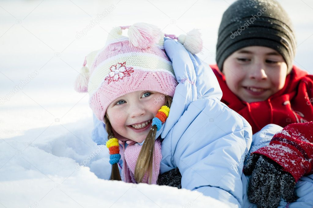 Portrait of children playing in the snow in the winter