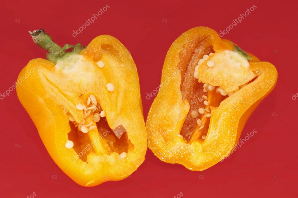 Yellow peppers paprika on red background