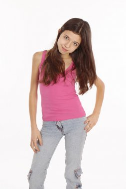 Portrait of the nice teen girl in pink clothes