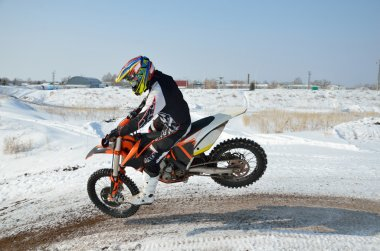 Motorcycle racer lands on the front wheel