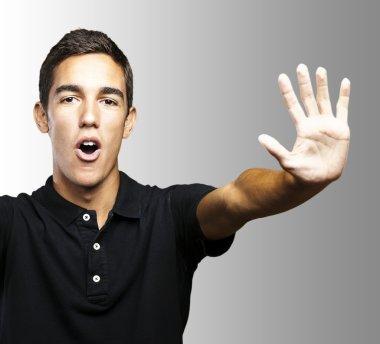 Young man stop symbol