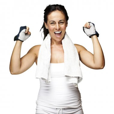 Portrait of a middle aged woman gesturing win symbol over white