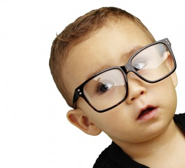 Portrait of kid wearing glasses over white background