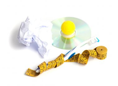 Disk,centimeter,toothbrush, yellow ball, paper