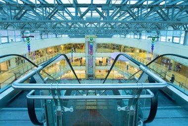 Shop escalator in shopping center