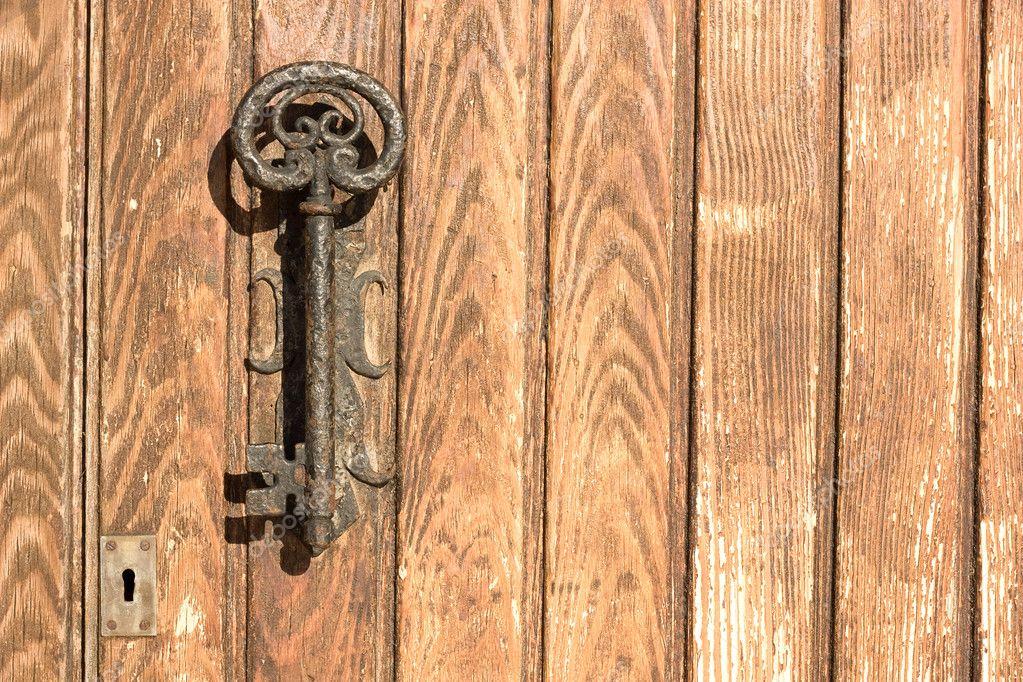The old door handle in the form of key. — Stock Photo © alika #8039890