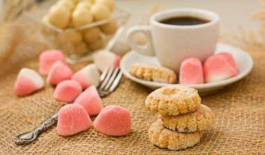 Sweet cookies and coffee.