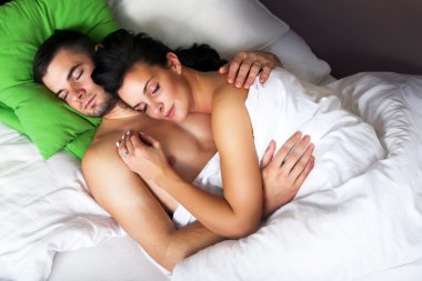 Young couple sleeping in a bed