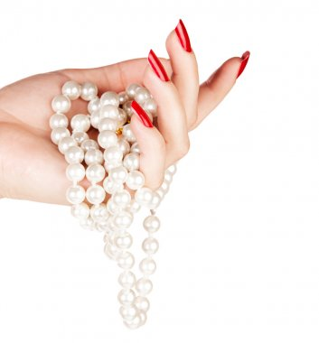 Hand of woman with pearls