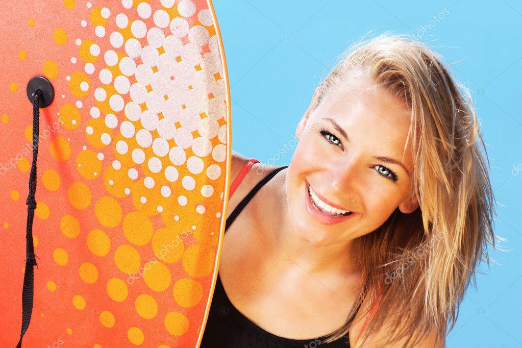 Happy surfer beautiful teen girl