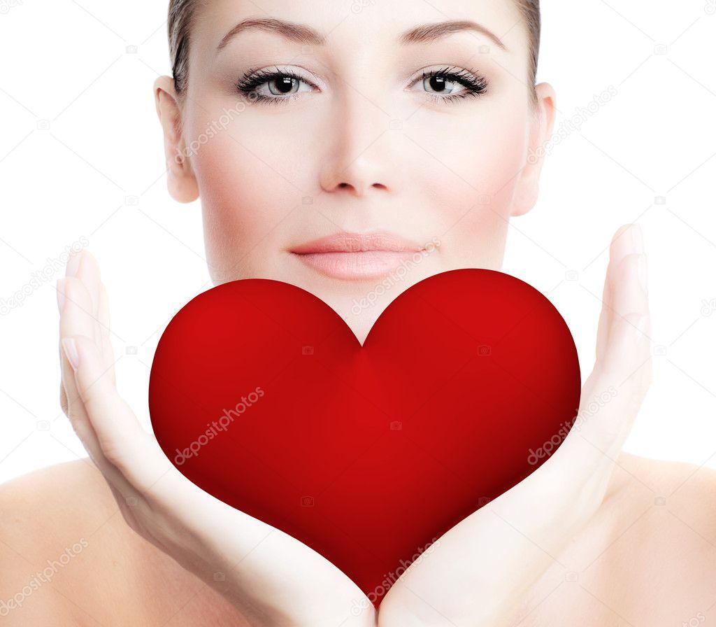 belle femme tenant gros coeur rouge photographie anna om 8859540. Black Bedroom Furniture Sets. Home Design Ideas