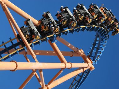 Moving roller coaster with blue sky