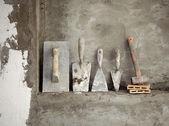 Fotografia Malta di cemento invecchiato costruzione utilizzati strumenti