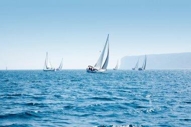 Boats sail regatta with sailboats in mediterranean
