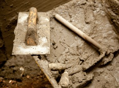 Cement mortar dirty tools like trowel